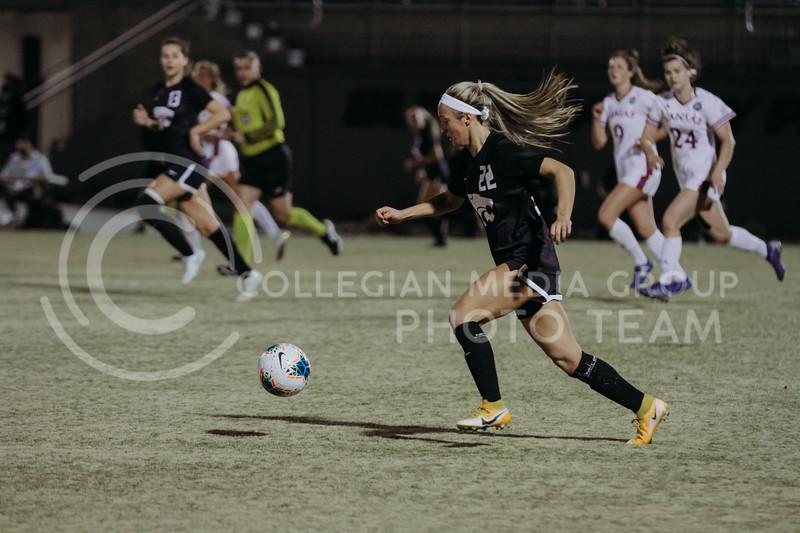 Freshman forward Maddie Weichel prepares to kick the ball during the March 6, 2021 game against KU. (Sophie Osborn | Collegian Media Group)