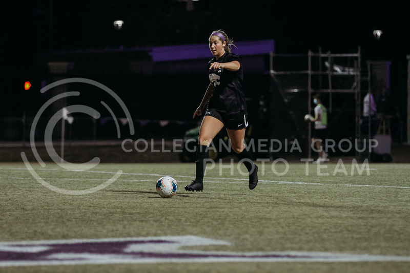 Sophomore midfielder Shae Turner moves the ball towards the goal during the March 6, 2021 game against KU. (Sophie Osborn | Collegian Media Group)