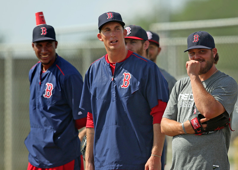 """I had just finished shooting the intrasquad game (with shallow depth of field, natch) and was struck by Henry Owens' demeanor in the drill going on in the field across the way. I didn't even notice Ogando until I was editing. Another for the """"Shots I Missed"""" file..."""