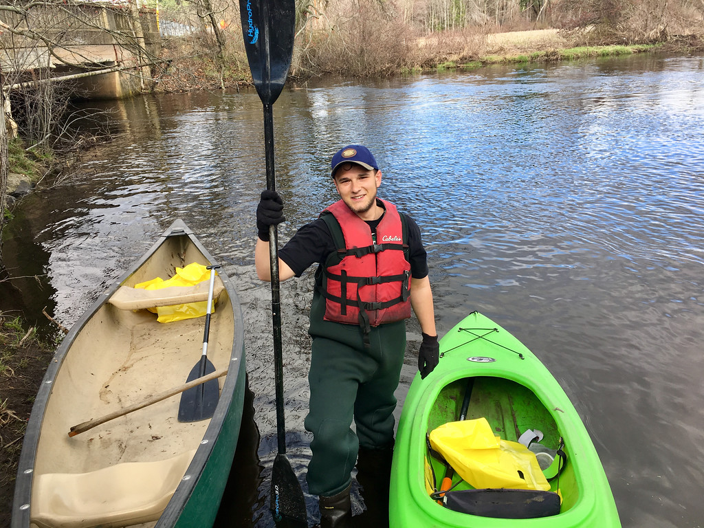 . Justin Damon of Billerica prepared to clean up the Shawsheen River. Photo by Mary Leach