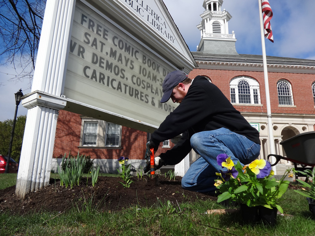 . Matt Pustizzi, a circulation assistant at the Billerica Library, spruced up the flower bed. Photo by Mary Leach