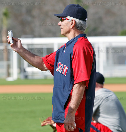 FORT MYERS, FL, Feb. 18, 2012: Boston Red Sox manager Bobby Valentine uses a video camera to record Red Sox pitcher Daisuke Matsuzaka playing long toss during informal workouts at Fenway South, the team's Spring Training and Player Development Complex. (Brita Meng Outzen/Boston Red Sox)