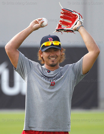 FORT MYERS, FL, Feb. 18, 2012: Boston Red Sox pitcher Daisuke Matsuzaka, who underwent Tommy John elbow surgery in June 2011, smiles during long toss at Fenway South, the team's Spring Training and Player Development Complex. (Brita Meng Outzen/Boston Red Sox)