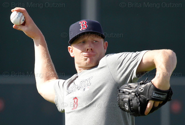 FORT MYERS, FL, Feb. 18, 2012: Boston Red Sox pitcher Mark Melancon throws the baseball while playing long toss during informal workouts at Fenway South, the team's Spring Training and Player Development Complex. (Brita Meng Outzen/Boston Red Sox)