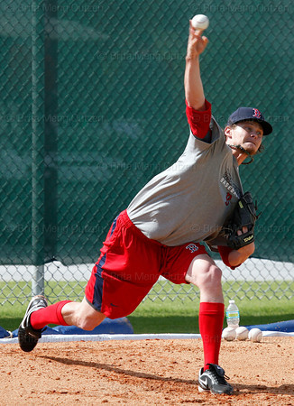 FORT MYERS, FL, Feb. 18, 2012: Boston Red Sox pitcher Clay Buchholz throws the baseball during his bullpen session during informal workouts at Fenway South, the team's Spring Training and Player Development Complex. (Brita Meng Outzen/Boston Red Sox)