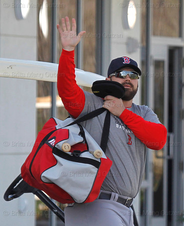 FORT MYERS, FL, Feb. 18, 2012: Boston Red Sox catcher Kelly Shoppach waves as he exits the clubhouse at the start of an informal workout at Fenway South, the team's Spring Training and Player Development Complex. (Brita Meng Outzen/Boston Red Sox)