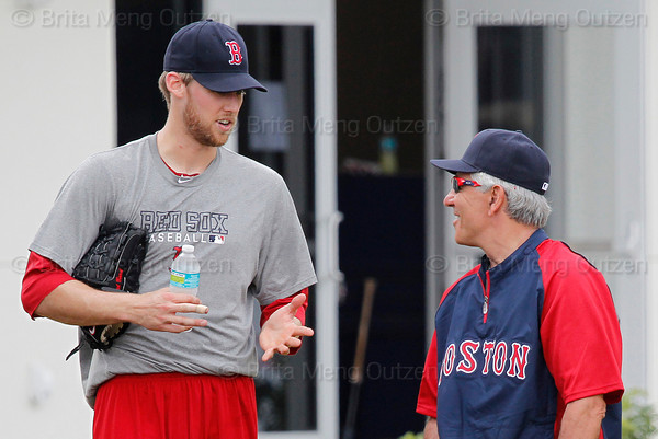 FORT MYERS, FL, Feb. 18, 2012: Boston Red Sox pitcher Daniel Bard, left, talks with Red Sox manager Bobby Valentine after throwing a bullpen session at informal workouts at Fenway South, the team's Spring Training and Player Development Complex. (Brita Meng Outzen/Boston Red Sox)