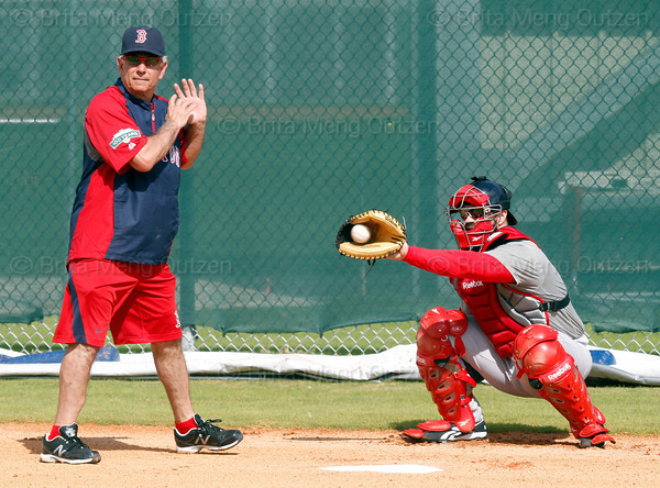FORT MYERS, FL, Feb. 18, 2012: Boston Red Sox manager Bobby Valentine, left, stands in the batter's box as Red Sox catcher Kelly Shoppach catches a pitch from Clay Buchholz during a bullpen session at informal workouts at Fenway South, the team's Spring Training and Player Development Complex. (Brita Meng Outzen/Boston Red Sox)