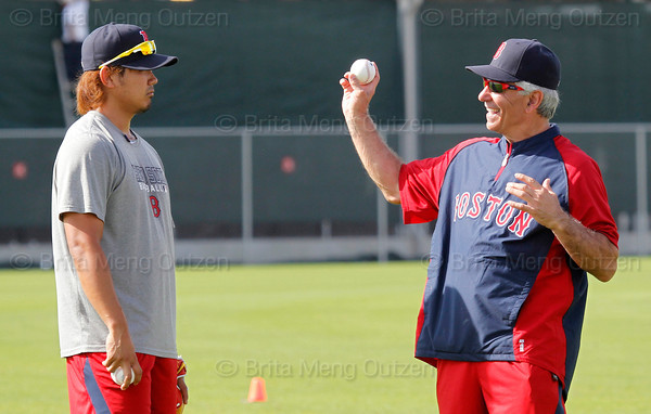 FORT MYERS, FL, Feb. 18, 2012: Boston Red Sox manager Bobby Valentine, right, talks with Red Sox pitcher Daisuke Matsuzaka during informal workouts at Fenway South, the team's Spring Training and Player Development Complex. (Brita Meng Outzen/Boston Red Sox)