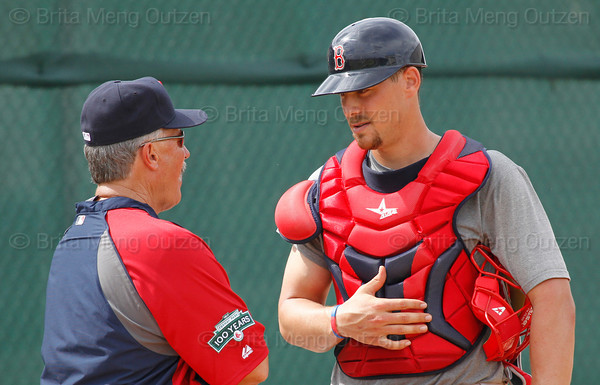 FORT MYERS, FL, Feb. 18, 2012: Boston Red Sox catcher Ryan Lavarnway, right, talks wtih Red Sox pitching coach Bob McClure after catching pitcher Alex Wilson's bullpen session during informal workouts at Fenway South, the team's Spring Training and Player Development Complex. (Brita Meng Outzen/Boston Red Sox)