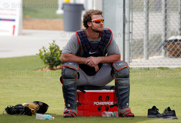 FORT MYERS, FL, Feb. 18, 2012: Boston Red Sox catcher Jarrod Saltalamacchia sits on a cooler as he watches pitchers throw bullpen sessions during informal workouts at Fenway South, the team's Spring Training and Player Development Complex. (Brita Meng Outzen/Boston Red Sox)