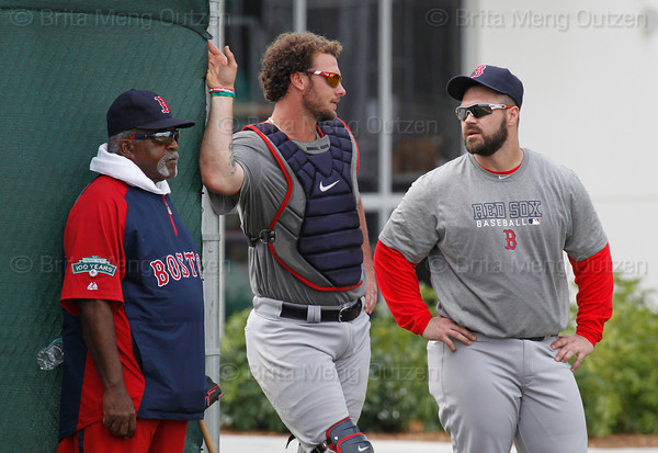 FORT MYERS, FL, Feb. 18, 2012: Boston Red Sox catchers Jarrod Saltalamacchia, center, and Kelly Shoppach, right, talk as they and special assignment instructor Luis Tiant watch pitchers throw bulpen sessions during informal workouts at Fenway South, the team's Spring Training and Player Development Complex. (Brita Meng Outzen/Boston Red Sox)