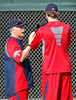 FORT MYERS, FL, Feb. 18, 2012: Boston Red Sox pitching coach Bob McClure, left, works with pitcher Andrew Miller during informal workouts at Fenway South, the team's Spring Training and Player Development Complex. (Brita Meng Outzen/Boston Red Sox)