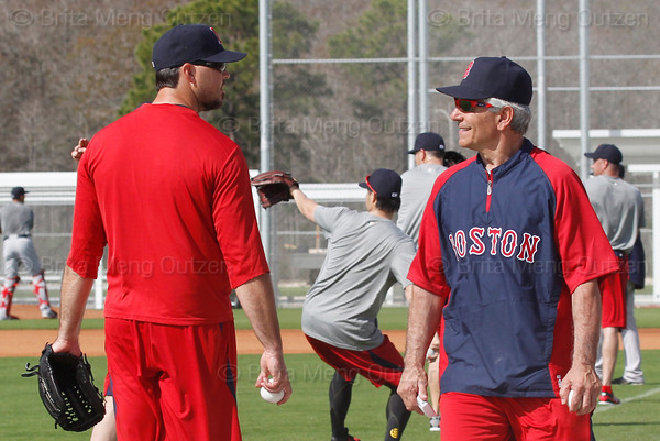 FORT MYERS, FL, Feb. 18, 2012: Boston Red Sox pitcher Josh Beckett, left, speaks with Red Sox manager Bobby Valentine during informal workouts at Fenway South, the team's Spring Training and Player Development Complex. (Brita Meng Outzen/Boston Red Sox)