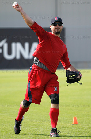 FORT MYERS, FL, Feb. 18, 2012: Boston Red Sox pitcher Josh Beckett throws the baseball while playing long toss during informal workouts at Fenway South, the team's Spring Training and Player Development Complex. (Brita Meng Outzen/Boston Red Sox)