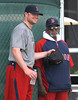 FORT MYERS, FL, Feb. 18, 2012: Boston Red Sox pitcher Jon Lester, left, smiles after special assignment instructor Luis Tiant comments on his bullpen session at informal workouts at Fenway South, the team's Spring Training and Player Development Complex. (Brita Meng Outzen/Boston Red Sox)