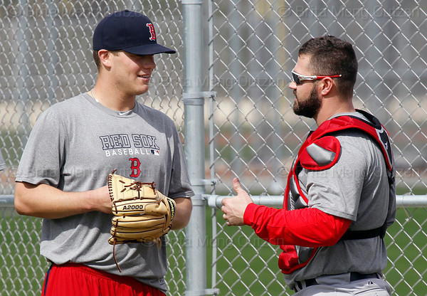 FORT MYERS, FL, Feb. 18, 2012: Boston Red Sox pitcher Andrew Bailey, left, and catcher Kelly Shoppach chat prior to Bailey's bullpen session during informal workouts at Fenway South, the team's Spring Training and Player Development Complex. (Brita Meng Outzen/Boston Red Sox)
