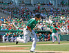 FORT MYERS, FL, March 17, 2012:  Boston Red Sox batter Lars Anderson, left, runs to first base after hitting an RBI single off Baltimore Orioles pitcher Armando Galarraga as Red Sox base runner Kelly Shoppach runs home in the fourth inning of a split-squad Grapefruit League spring training game at JetBlue Park at Fenway South. (Brita Meng Outzen/Boston Red Sox)