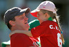 "FORT MYERS, FL, March 17, 2012: A father and daughter sing ""Sweet Caroline"" together in the middle of the eighth inning of the Boston Red Sox split-squad Grapefruit League spring training game against the Baltimore Orioles at JetBlue Park at Fenway South. (Brita Meng Outzen/Boston Red Sox)"