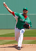 FORT MYERS, FL, March 17, 2012: Boston Red Sox pitcher Josh Beckett, wearing the team's green St. Patrick's Day uniform jersey and hat, throws a warmup pitch before the first inning of a split-squad Grapefruit League spring training game against the Baltimore Orioles at JetBlue Park at Fenway South. (Brita Meng Outzen/Boston Red Sox)