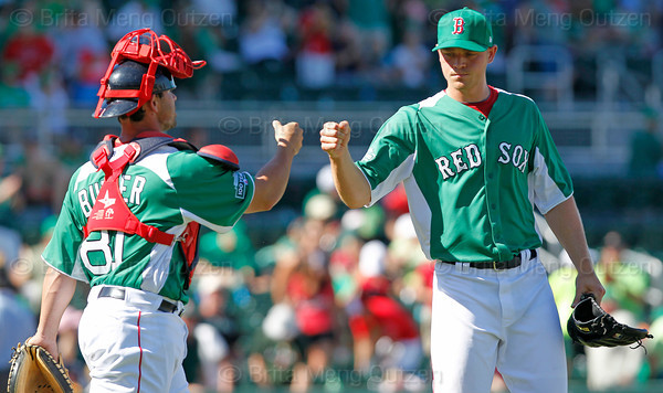 FORT MYERS, FL, March 17, 2012: Boston Red Sox catcher Daniel Butler, left, and pitcher Michael Bowden bump fists after winning a split-squad Grapefruit League spring training game against the Baltimore Orioles , 7-4, at JetBlue Park at Fenway South. (Brita Meng Outzen/Boston Red Sox)