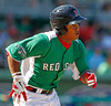 FORT MYERS, FL, March 17, 2012: Boston Red Sox batter Heiker Meneses runs to first base after hitting a pitch from Baltimore Orioles pitcher Pat Neshek in the seventh inning of a split-squad Grapefruit League spring training game at JetBlue Park at Fenway South. (Brita Meng Outzen/Boston Red Sox)