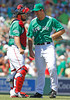 FORT MYERS, FL, March 17, 2012: Boston Red Sox pitcher Ross Ohlendorf, right, and catcher Kelly Shoppach share a laugh during a conference on the mound prior to the sixth inning of a split-squad Grapefruit League spring training game against the Baltimore Orioles at JetBlue Park at Fenway South. (Brita Meng Outzen/Boston Red Sox)