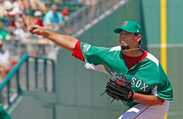 FORT MYERS, FL, March 17, 2012: Boston Red Sox pitcher Josh Beckett, wearing the team's green St. Patrick's Day uniform jersey and hat, throws a pitch to a Baltimore Orioles batter in the  third inning of a split-squad Grapefruit League spring training game against the Baltimore Orioles at JetBlue Park at Fenway South. (Brita Meng Outzen/Boston Red Sox)