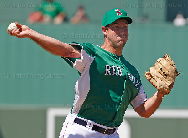 FORT MYERS, FL, March 17, 2012: Boston Red Sox pitcher Ross Ohlendorf makes a pickoff throw to first base in the sixth inning of a split-squad Grapefruit League spring training game against the Baltimore Orioles at JetBlue Park at Fenway South. (Brita Meng Outzen/Boston Red Sox)