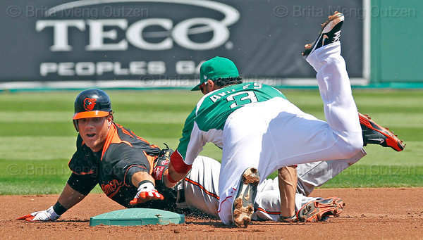 FORT MYERS, FL, March 17, 2012: Boston Red Sox shortstop Mike Aviles, right, lunges to tag Baltimore Orioles batter Chris Davis before he can touch second base in the second inning of a split-squad Grapefruit League spring training game at JetBlue Park at Fenway South. Davis was out on the play. (Brita Meng Outzen/Boston Red Sox)