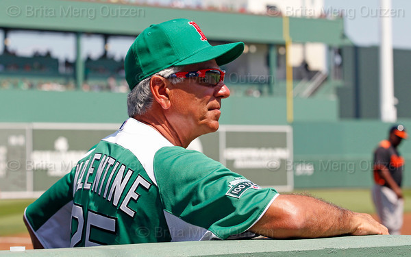 FORT MYERS, FL, March 17, 2012: Boston Red Sox manager Bobby Valentine, wearing the team's traditional green St. Patrick's Day uniform jersey and hat, watches Red Sox pitcher Josh Beckett warm up before the first inning of a split-squad Grapefruit League spring training game against the Baltimore Orioles at JetBlue Park at Fenway South. (Brita Meng Outzen/Boston Red Sox)