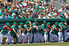 FORT MYERS, FL, March 17, 2012: Members of the Boston Red Sox, dressed in the team's traditional green St. Patrick's Day uniform jerseys and hats, watch the action on the field in the third inning of a split-squad Grapefruit League spring training game against the Baltimore Orioles at JetBlue Park at Fenway South. (Brita Meng Outzen/Boston Red Sox)