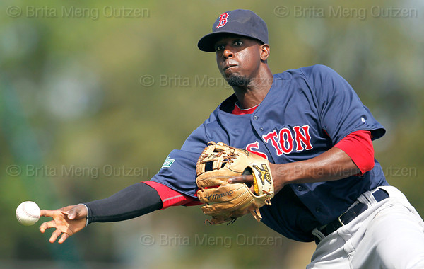 FORT MYERS, FL, March 7, 2012: Boston Red Sox second baseman Pedro Ciriaco throws the baseball to first base in the third inning of a B game against the Minnesota Twins at Hammond Stadium. (Brita Meng Outzen/Boston Red Sox)
