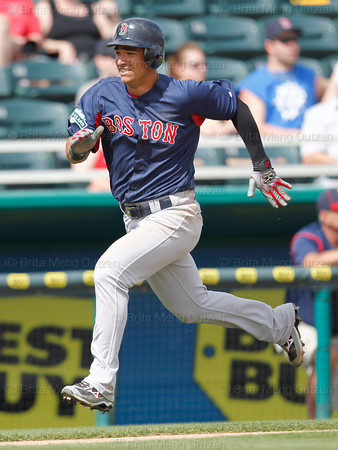 FORT MYERS, FL, March 7, 2012: Boston Red Sox base runner Jose Iglesias heads for home on an RBI single by teammate Will Middlebrooks in the fifth inning of a B game against the Minnesota Twins at Hammond Stadium. (Brita Meng Outzen/Boston Red Sox)