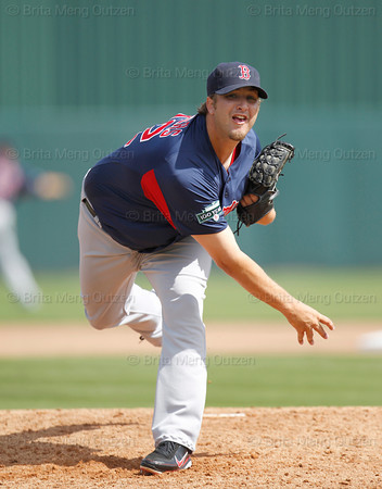 FORT MYERS, FL, March 7, 2012: Boston Red Sox pitcher Matt Albers follows through on a warmup pitch before the fourth inning of a B game against the Minnesota Twins at Hammond Stadium. (Brita Meng Outzen/Boston Red Sox)