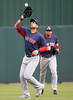 FORT MYERS, FL, March 7, 2012: Boston Red Sox right fielder Josh Kroeger, left, catches a fly ball hit by a Minnesota Twins batter as center fielder Jason Repko watches in the fifth inning of a B game at Hammond Stadium. (Brita Meng Outzen/Boston Red Sox)