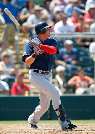 FORT MYERS, FL, March 30, 2012: Boston Red Sox batter Ryan Sweeney watches his double off Minnesota Twins pitcher Jeff Gray in the sixth inning of a Grapefruit League spring training game at Hammond Stadium. (Brita Meng Outzen/Boston Red Sox)