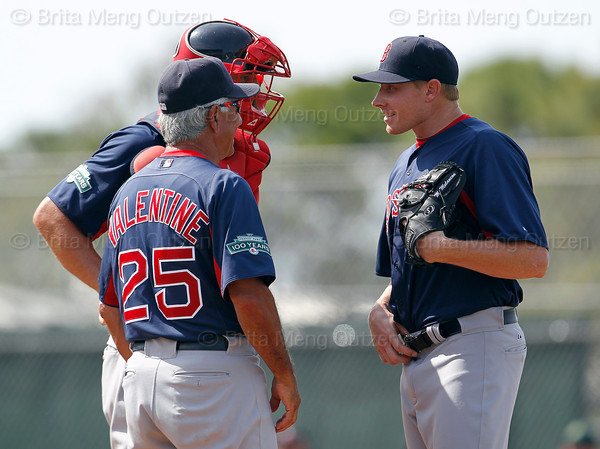 FORT MYERS, FL, March 30, 2012: Boston Red Sox pitcher Mark Melancon, right, and catcher Ryan Lavarnway, center, talk with manager Bobby Valentine during a mound conference in the ninth inning of a Grapefruit League spring training game against the Minnesota Twins at Hammond Stadium. (Brita Meng Outzen/Boston Red Sox)