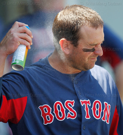 FORT MYERS, FL, March 30, 2012: Boston Red Sox infielder Nick Punto sprays on the sunscreen in the dugout before taking the field for a Grapefruit League spring training game against the Minnesota Twins  at Hammond Stadium. (Brita Meng Outzen/Boston Red Sox)