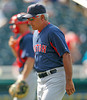 FORT MYERS, FL, March 30, 2012: Boston Red Sox manager Bobby Valentine walks back to the dugout after a mound conference with pitcher Mark Melancon and catcher Ryan Lavarnway in the ninth inning of a Grapefruit League spring training game against the Minnesota Twins at Hammond Stadium. (Brita Meng Outzen/Boston Red Sox)