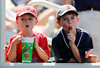 FORT MYERS, FL, March 30, 2012: Two young Boston Red Sox fans have a snack break as they peer into the Red Sox dugout during the sixth inning of a Grapefruit League spring training game against the Minnesota Twins at Hammond Stadium. (Brita Meng Outzen/Boston Red Sox)