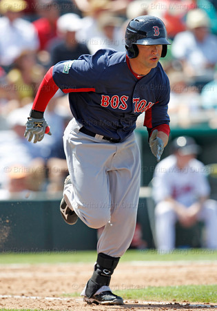 FORT MYERS, FL, March 30, 2012: Boston Red Sox batter Bryce Brentz runs to first base after making contact with a pitch from Minnesota Twins pitcher Jeff Gray in the seventh inning of a Grapefruit League spring training game at Hammond Stadium. (Brita Meng Outzen/Boston Red Sox)