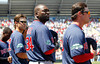FORT MYERS, FL, March 30, 2012: From left, Boston Red Sox players Peter Hissey, David Ortiz and Bryce Brentz stand at attention during the National Anthem prior to a Grapefruit League spring training game against the Minnesota Twins at Hammond Stadium. (Brita Meng Outzen/Boston Red Sox)