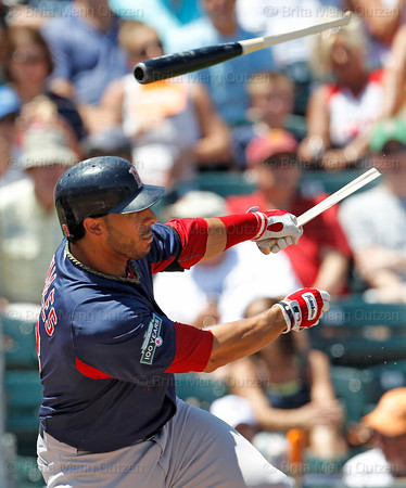 FORT MYERS, FL, March 30, 2012: Boston Red Sox batter Mike Aviles breaks his bat while singling off Minnesota Twins pitcher Nick Blackburn in the second inning of a Grapefruit League spring training game at Hammond Stadium. (Brita Meng Outzen/Boston Red Sox)
