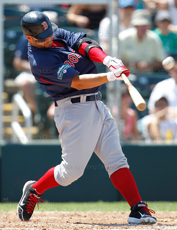FORT MYERS, FL, March 30, 2012: Boston Red Sox batter Cody Ross hits a two-run home run off Minnesota Twins pitcher Jeff Gray in the sixth inning of a Grapefruit League spring training game at Hammond Stadium. (Brita Meng Outzen/Boston Red Sox)