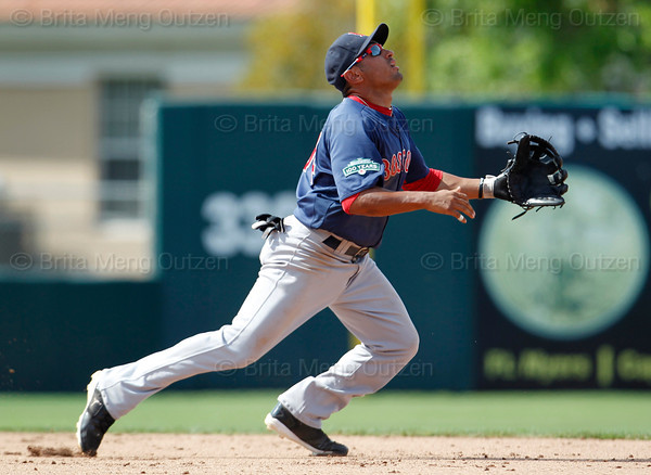 FORT MYERS, FL, March 30, 2012:  Boston Red Sox second baseman Ryan Dent looks for the baseball after committing a fielding error in the ninth inning of a Grapefruit League spring training game against the Minnesota Twins at Hammond Stadium. (Brita Meng Outzen/Boston Red Sox)
