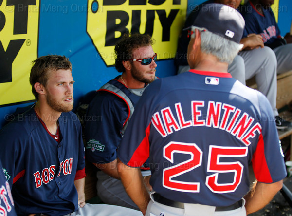 FORT MYERS, FL, March 30, 2012:  Boston Red Sox pitcher Daniel Bard, left, talks with manager Bobby Valentine, right, in the dugout after the sixth inning of a Grapefruit League spring training game against the Minnesota Twins at Hammond Stadium. (Brita Meng Outzen/Boston Red Sox)