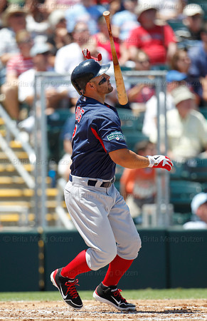 FORT MYERS, FL, March 30, 2012: Boston Red Sox batter Cody Ross flips his bat after hitting a solo home run off Minnesota Twins pitcher Nick Blackburn in the second inning of a Grapefruit League spring training game at Hammond Stadium. (Brita Meng Outzen/Boston Red Sox)
