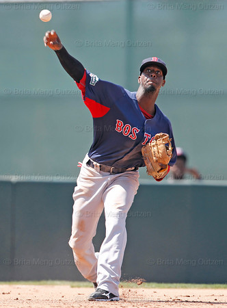 FORT MYERS, FL, March 30, 2012: Boston Red Sox third baseman Pedro Ciriaco throws a baseball hit by Minnesota Twins batter Trevor Plouffe to first base in the seventh inning of a Grapefruit League spring training game at Hammond Stadium. (Brita Meng Outzen/Boston Red Sox)