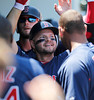 FORT MYERS, FL, March 30, 2012: Boston Red Sox batter Cody Ross is congratulated by teammates in the dugout after hitting a solo home run off Minnesota Twins pitcher Nick Blackburn in the second inning of a Grapefruit League spring training game at Hammond Stadium. (Brita Meng Outzen/Boston Red Sox)